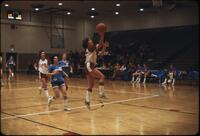 "An Augsburg women's basketball team player ""Kim"" landing a layup, March 1979"