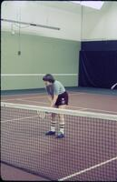 An Augsburg women's tennis team player standing in ready position, April 1977