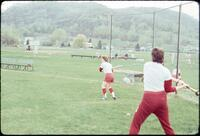 Augsburg women's softball team players practicing hitting, April 1977