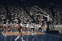 An Augsburg women's basketball team player shooting the ball from the side, circa 1979