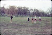 Augsburg women's softball team practicing together, April 1977