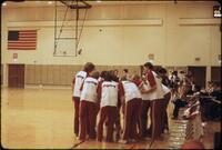 Augsburg women's basketball team huddling, February 1978