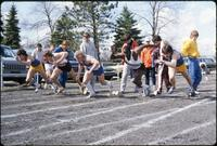 An Augsburg men's track and field team runner in a race, 1982.