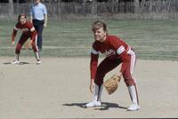 Augsburg women's softball team outfield players in action, 1982.