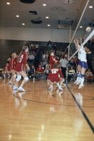 Augsburg women's volleyball team clumping together to guard, circa 1979