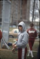 Augsburg women's softball team players warm up, 1982.
