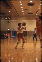 An Augsburg women's basketball player passing the ball from the sidelines, February 1980