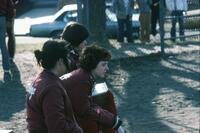 Augsburg women's tennis team players sitting on a bench, circa 1979