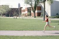 An Augsburg women's track and field team runner in motion, 1981.