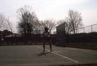 An Augsburg women's tennis team player standing in position, circa 1979