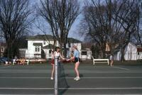 An Augsburg women's tennis team player shaking hands with a rival player, circa 1979