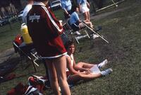 Augsburg women's tennis team sitting together near some sports drinks, circa 1979