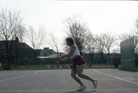 An Augsburg women's tennis team player running towards the tennis ball, circa 1979