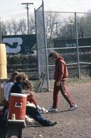 Augsburg women's softball team coaches and players on the bench, 1981.