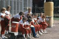 Augsburg women's softball team on the bench during a game, 1981.
