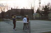 An Augsburg women's tennis team player talking with the coach, circa 1979