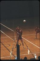 An Augsburg women's volleyball team player jumping to block a ball, October 1979