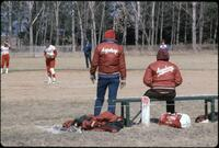 Augsburg women's softball team standing in position on the field, April 1980
