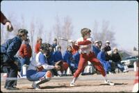 An Augsburg women's softball team batter in action during a game, 1980.