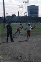 Augsburg women's softball team outfield players in action, 1981.