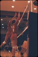 Two Augsburg women's volleyball team players jumping with the hands up, October 1979