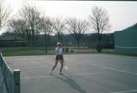 An Augsburg women's tennis team player posing for a photo, circa 1979