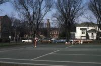 An Augsburg women's tennis team player on a tennis court in Winona, circa 1979