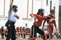 A catcher throws the ball, May 1983