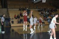An Augsburg women's basketball player goes for a shot, February 1983
