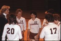Augsburg women's volleyball team players huddled around their coach, October 1983