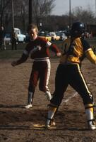 An Augsburg women's softball player runs to home base, April 1983