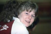 An Augsburg women's basketball player smiling for camera, February 1983