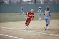 An Augsburg women's softball player running past third base, April 1983