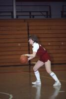 An Augsburg women's basketball player dribbles ball, February 1983