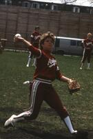 An Augsburg women's softball player throwing the ball, May 1983