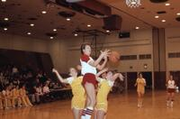 An Augsburg women's basketball player goes for a score, March 1982