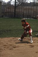 An Augsburg women's softball player misses catching ball, May 1983
