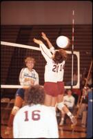 Volleyball flies past two Augsburg women's volleyball team players, September 1983