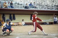 Augsburg women's softball batter swings, April 1983