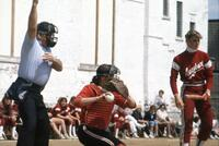 Augsburg women's softball catcher throwing ball, May 1983