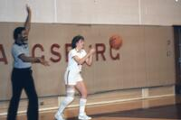 An Augsburg women's basketball player catching a ball, February 1983