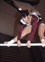 An Augsburg women's gymnastics team member about to swing, February 1983