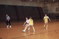 An Augsburg women's basketball player dribbles the ball, March 1982