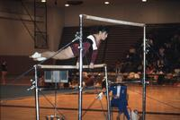 An Augsburg women's gymnastics team member on uneven bars, February 1983