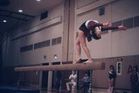 An Augsburg women's gymnastics team member doing routine on beam, January 1983