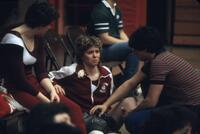 An Augsburg women's gymnastics team member getting knee iced, March 1983