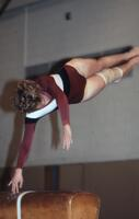 An Augsburg women's gymnastics team member horizontal in air, February 1983