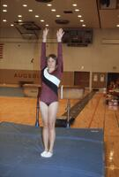 An Augsburg women's gymnastics team member poses after vault, January 1983