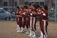 An Augsburg women's softball player clapping in a line, May 1983