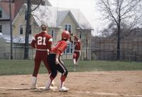 An Augsburg women's softball player jumps to catch ball, May 1983